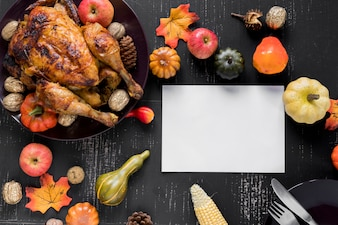 Sheet near roasted chicken, vegetables and fruits
