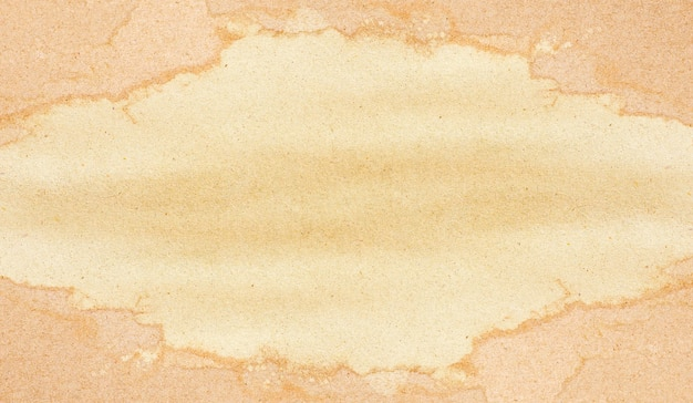 茶色の紙のシート。背景のフレームグランジテクスチャ。
