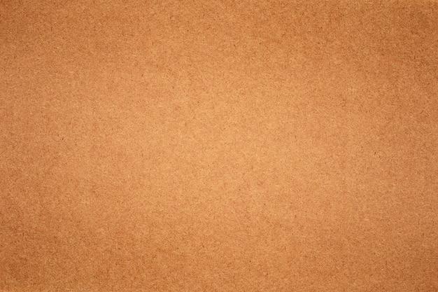벽에 갈색 종이 질감의 시트입니다.