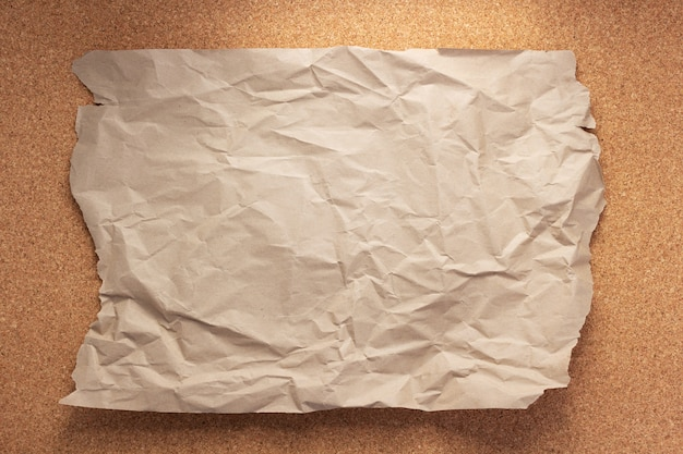 Sheet of paper at corkboard as background texture