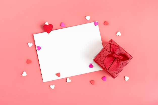 Sheet of paper for message, red envelope, gift box, candy in  shape of hearts. happy valentines day