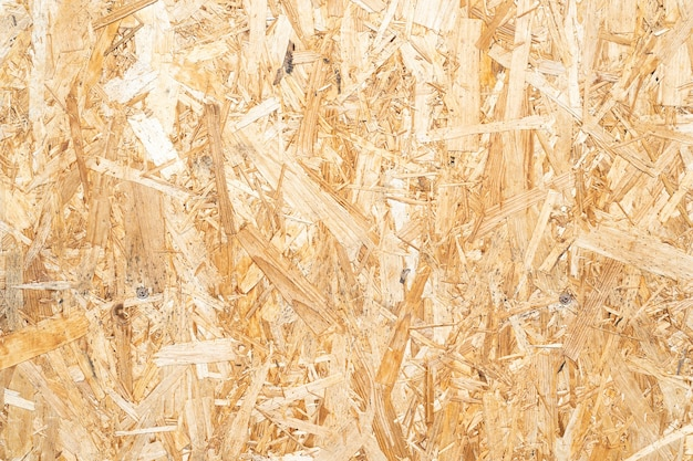 Sheet of plywood with fragments of compressed sawdust board wood high resolution texture background