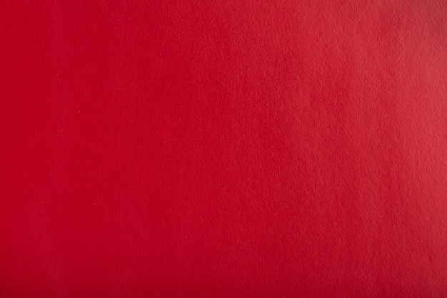 Sheet of red paper. smooth surface. abstract red background.