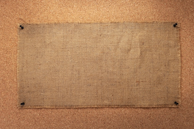 Sheet of sack hessian burlap texture pinned at corkboard as background