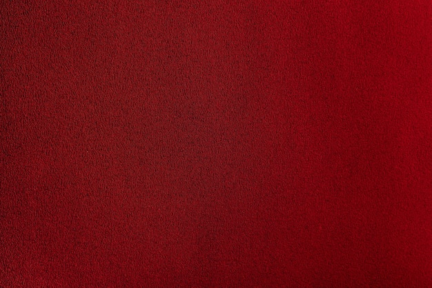 Sheet of scarlet paper. bordo dark smooth surface. abstract red background.