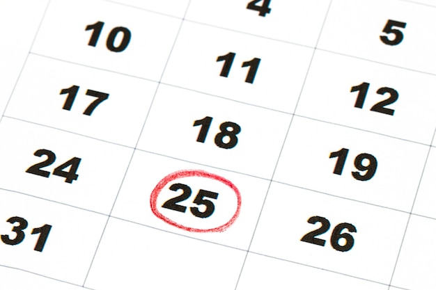 Sheet of wall calendar with red mark on 25 december - christmas