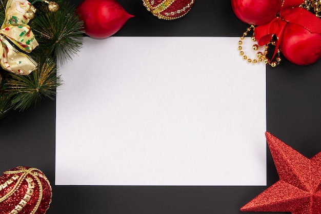 Sheet of white paper on christmas background top view mock up