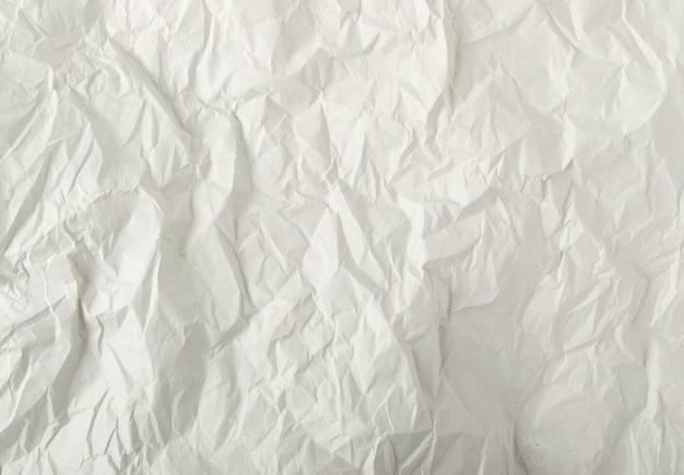 Sheet of white thin crumpled craft paper background top view. wrinkled grey wrapping paper texture or pattern