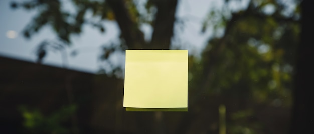 Sheets of note papers, stick notes paper, post it on mirror window