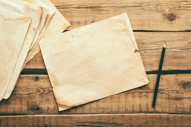 Sheets of old vintage paper on a wooden table. copy space