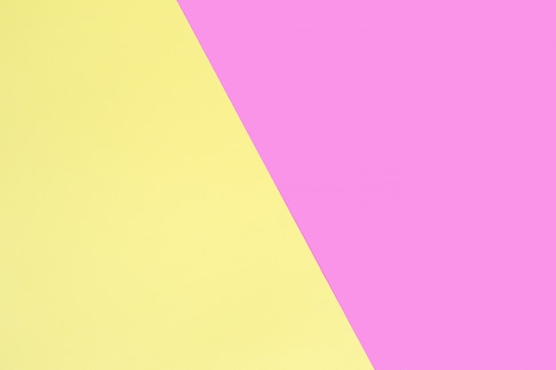 Sheets of pink and yellow paper.