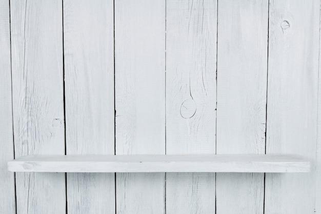 棚。木製の背景、白いペンキ。 Premium写真