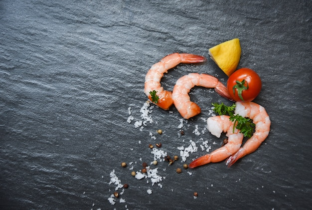 Shellfish fresh shrimps prawns ocean gourmet with tomato lemon and green parsley