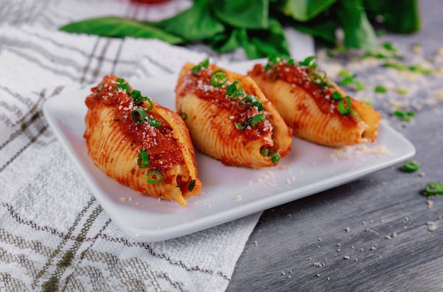 Shells pasta stuffed with a ricotta cheese and meat.
