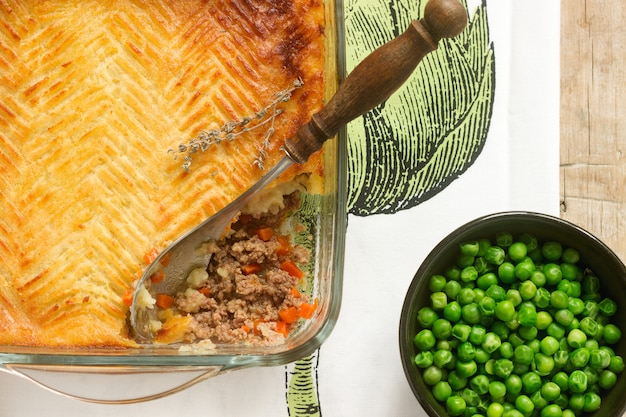 Shepherd's pie or cottage pie is a meat pie with a topping of mashed potato.