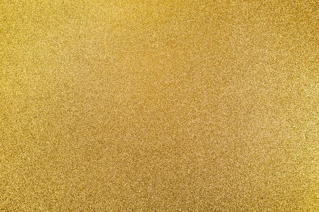 クリスマスの黄金shine.conceptのテクスチャの抽象的な背景