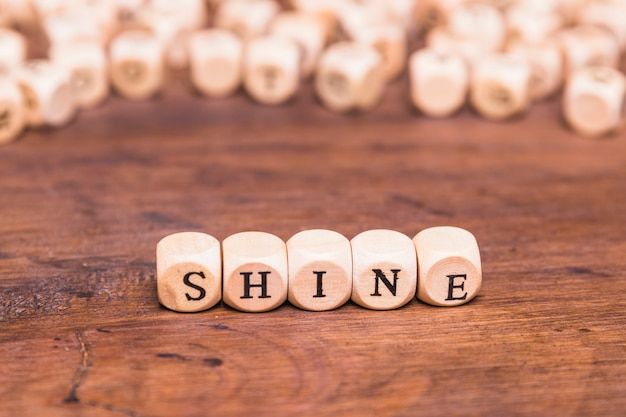 Shine word made with wooden cubes