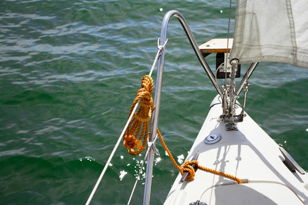Shine yacht tackle during voyage over sea waves, sailing concept.