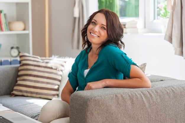 Shining face of beautiful woman at home