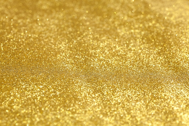 Shining gold glitter detailed texture for background