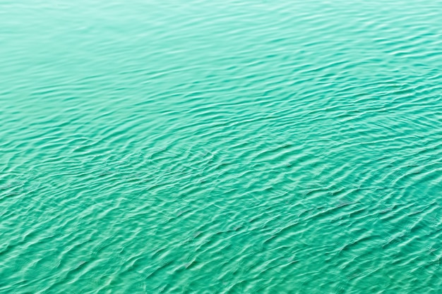 Shining green wavy water surface ripple background