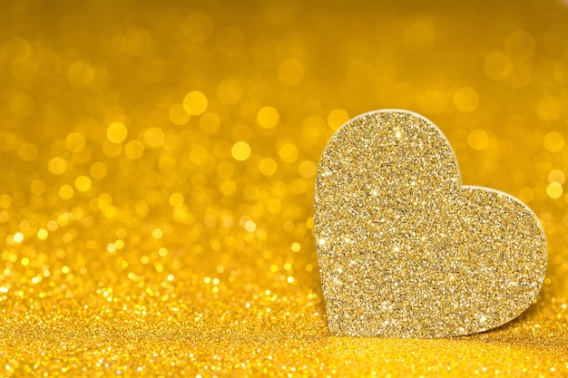 Shining heart on a golden radiant background. glitter shine with 3d shape.
