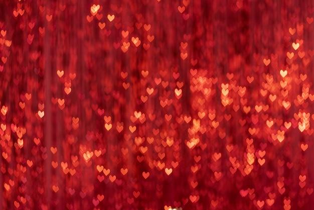 輝くハート型のスポットボケ味の背景ぼかしの装飾カーテン