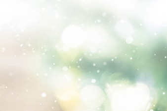 Shiny abstract bokeh background with snow