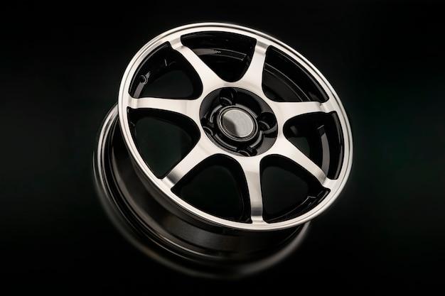 Shiny alloy wheel on a dark background.