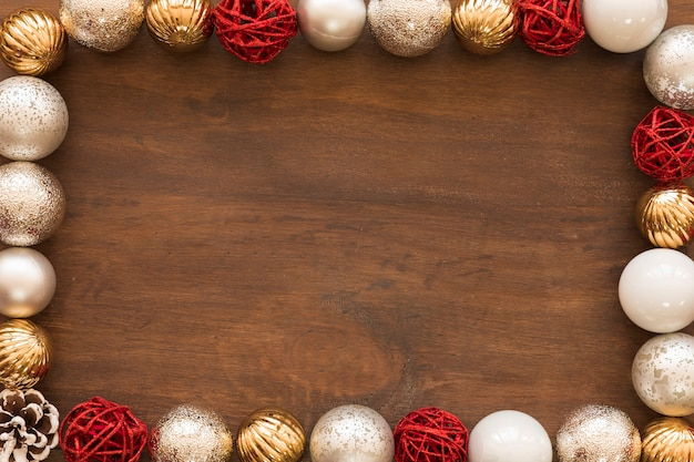 Shiny baubles on wooden table
