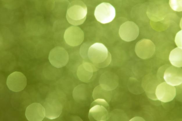 闪亮模糊的绿色闪光纹理背景