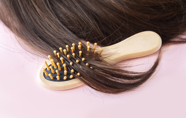 Shiny brown straight long hair with brush
