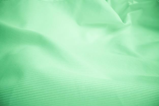 光沢のある流れる布テクスチャ背景