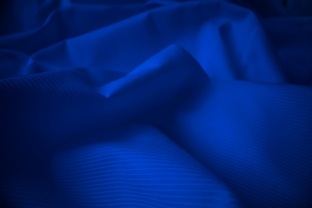 Shiny flowing cloth texture in macro shot.