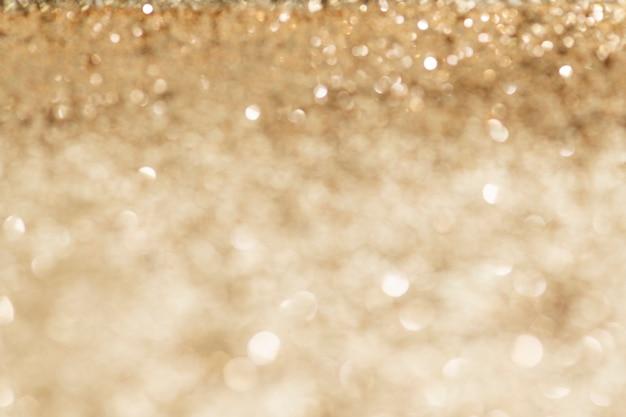 Shiny golden glitter background texture