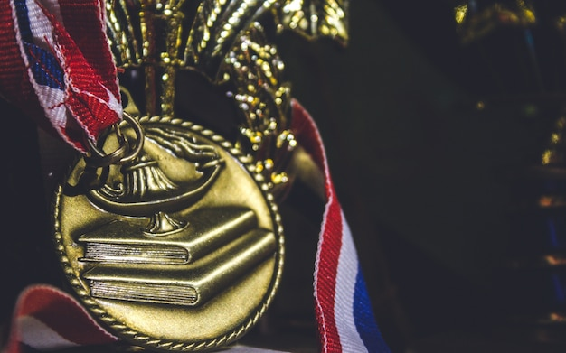 Shiny golden metal with ribbon red white and blue around it