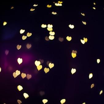 Shiny hearts on dark background