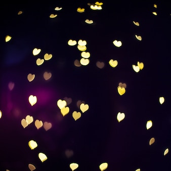 Shiny hearts on dark background