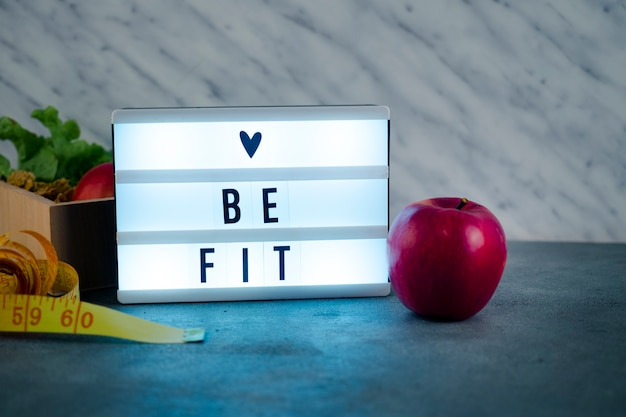 Shiny love be fit inscription on board with apple
