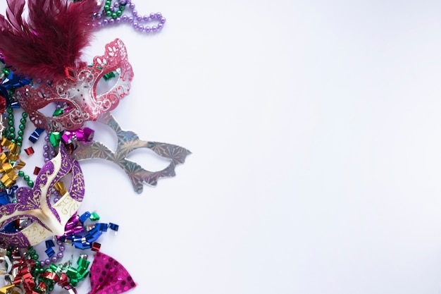 Shiny masks on confetti