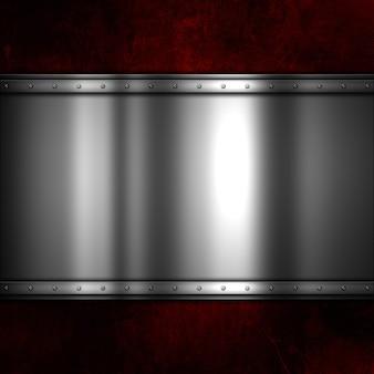 Блестящая металлическая пластина на красном гранж-фоне с царапинами и пятнами