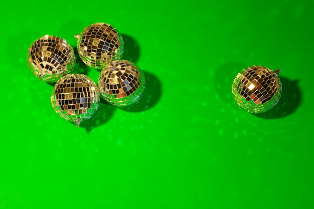 Shiny party disco balls shining in a day light over color