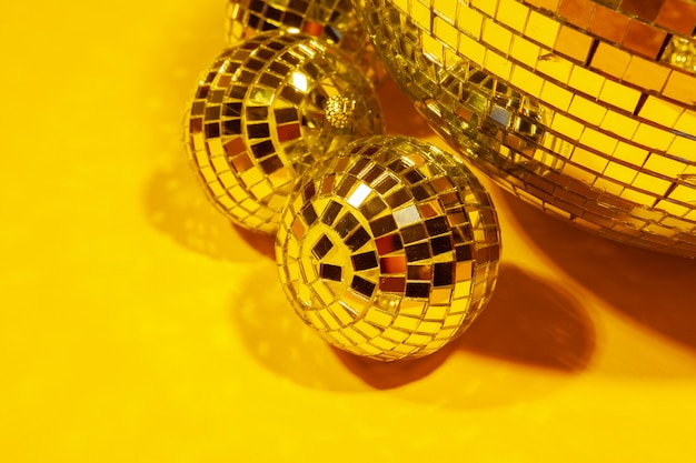 Shiny party disco balls shining in a day light