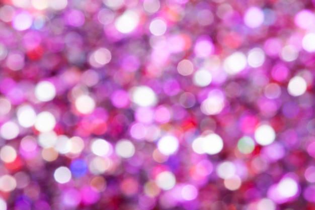 光沢のあるピンクのキラキラお祭りの背景