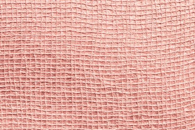 光沢のあるピンクの表面の織り目加工の背景