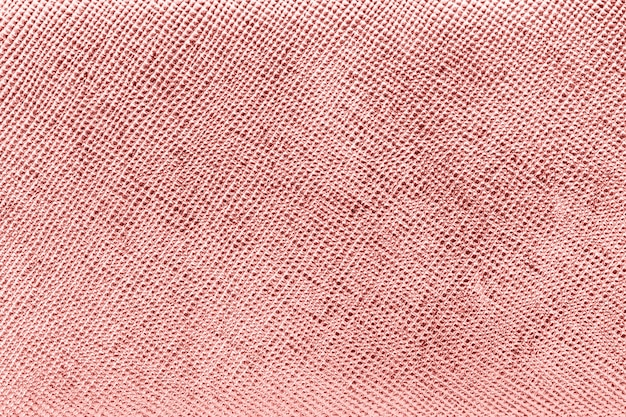 光沢のあるピンクの織り目加工の紙の背景