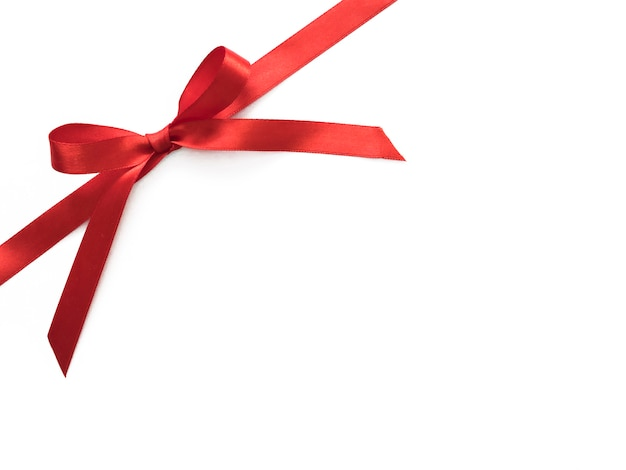 Shiny red satin ribbon bow isolated on white with copy space for your text