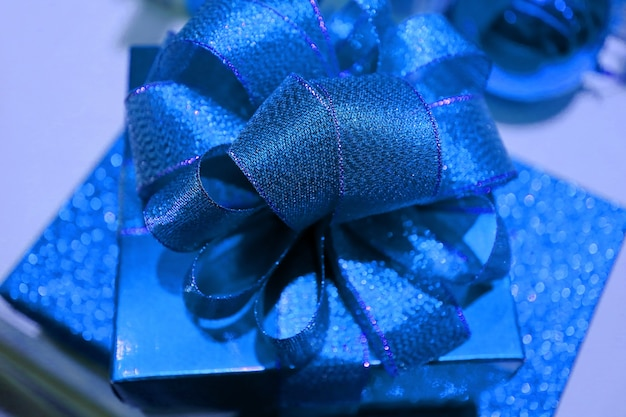 Shiny royal blue square shaped gift box with gritter blue ribbon bow