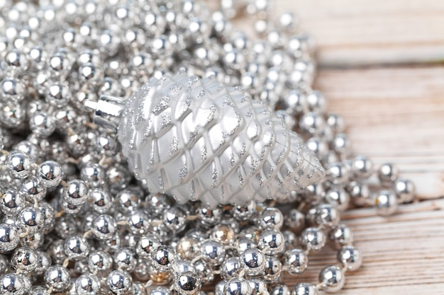Shiny silver glitter baubles close up on wooden table