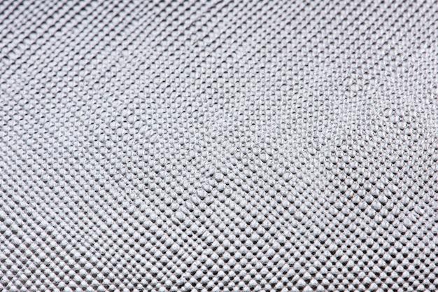 光沢のある銀の織り目加工の紙の背景